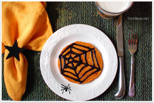 Spooky Pumpkin Pancakes with Black Cinnamon Syrup. Eating these pumpkin pancakes is so much more fun when you can draw your own design with the black cinnamon syrup. Click to get the pancake and syrup recipes at TidyMom.net