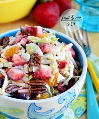 slaw with fruit and nuts in a blue bowl