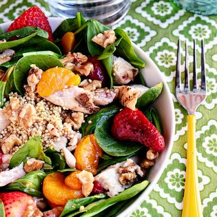 A hearty spring Strawberry Orange Spinach Salad with Quinoa is full of protein. Perfect for lunch or dinner on warm spring days. Print Full Recipe at TidyMom.net