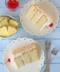 This cake has all the tropical flavors of a pina colada! Just like the favorite frozen cocktail, you will love the way the pineapple, coconut, and rum flavors take you right to paradise, right down to the cherry on top. Print the full cake and frosting recipe at TidyMom.net