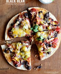 mexican pizza with black beans cut into four slices
