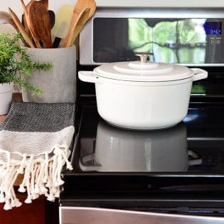 clean glass cooktop with white pot