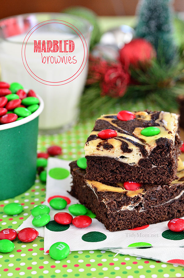 A swirl of cheesecake turns plain brownie mix into something special. Make Marbled Brownies holiday ready with M&Ms® Brand Chocolate Candies on top. Brownie recipe at TidyMom.net