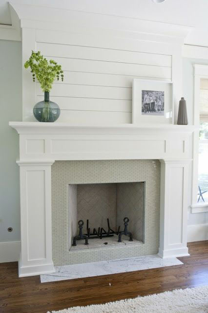 plank wall treatment over fireplace mantel