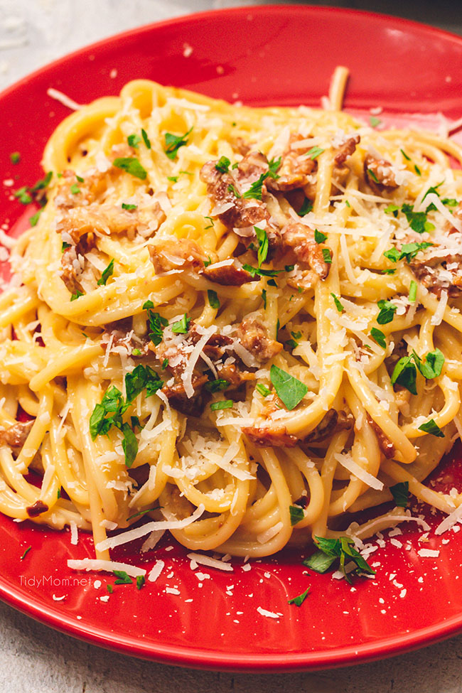 Easy and delicious classic Bacon Carbonara on a red plate