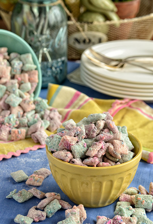 multi-colored Cake Batter Puppy Chow snack mix in a bowl