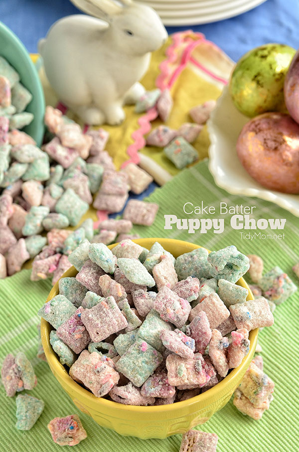 Cake Batter Puppy Chow Snack Mix is a doggone good crispy and delicious snack mix with the flavor of cake batter built in! Print the recipe at TidyMom.net #puppychow #muddybuddies #snacks #snackideas #eastertreats