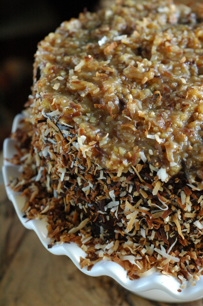 German Chocolate Cake infused with rum and toasted coconut! Jaw dropping Toasted Coconut German Chocolate Cake recipe at TidyMom.net