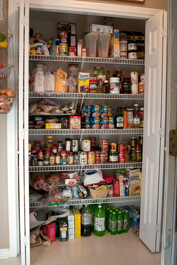Cluttered pantry - before pantry organization at TidyMom.net