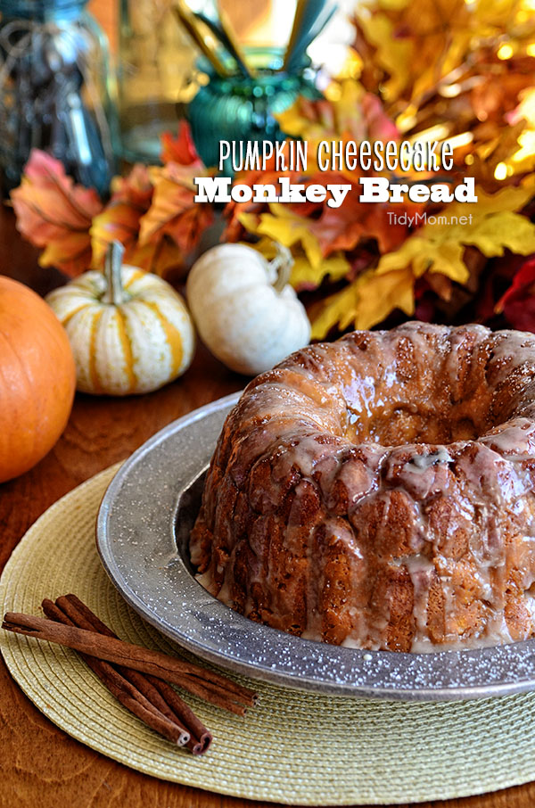 Pumpkin Cheesecake Monkey Bread is all gussied up for autumn with pumpkin, fall spices and a sweet maple glaze. Recipe at TidyMom.net