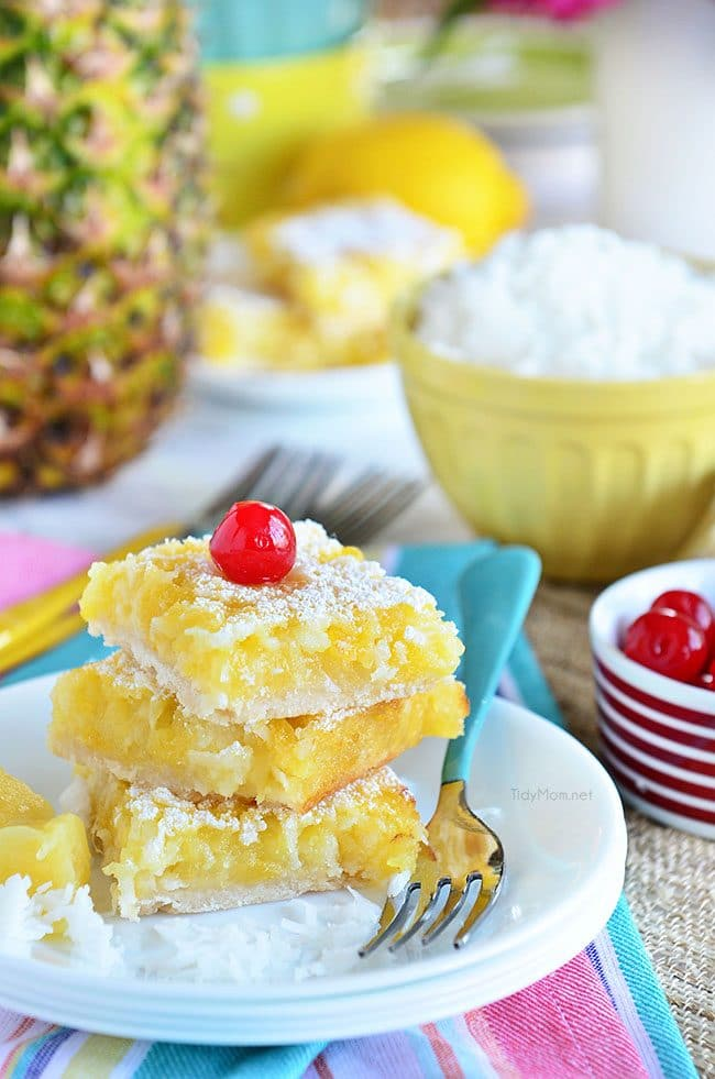Channel the tropics with these Pina Colada Bars. Enjoy the flavors of coconut and pineapple and consider it your ticket to a mental tropical paradise. grab the recipe at TidyMom.net