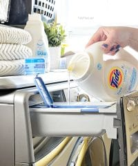 pouring liquid laundry detergent into washing machine