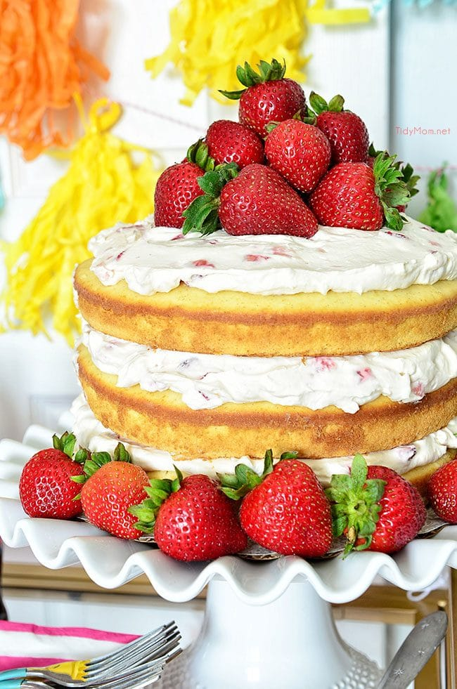 Homemade Strawberries and Cream Naked Cake recipe: 3 delicious layers of homemade pound cake, with fresh strawberries and a dreamy vanilla whipped cream cream cheese frosting at TidyMom.net