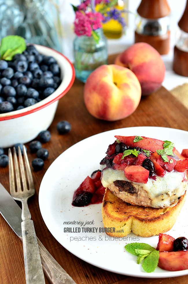 Butterball frozen turkey burgers make this summer meal quick and the peaches and blueberries add just a touch of sweet to the chili powder and garlic toast. Monterey Jack Grilled Turkey Burger with Peaches and Blueberries recipe at TidyMom.net #turkey #burger #burgerrecipe #grilled #grilling