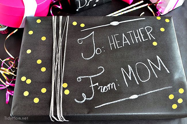 Such a fun inexpensive idea for gifting!!  DIY Chalkboard Gift Wrap at TidyMom.net