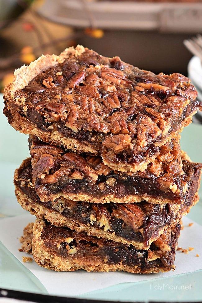 Gooey chocolate pecan pie bars on a plate