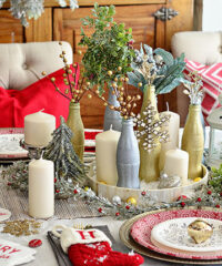 Use empty Coca Cola bottles as a pretty holiday table centerpiece. Just paint with glitter spray paint and add some holiday florals, and arrange on a tray. Easy and costs almost nothing! details at TidyMom.net