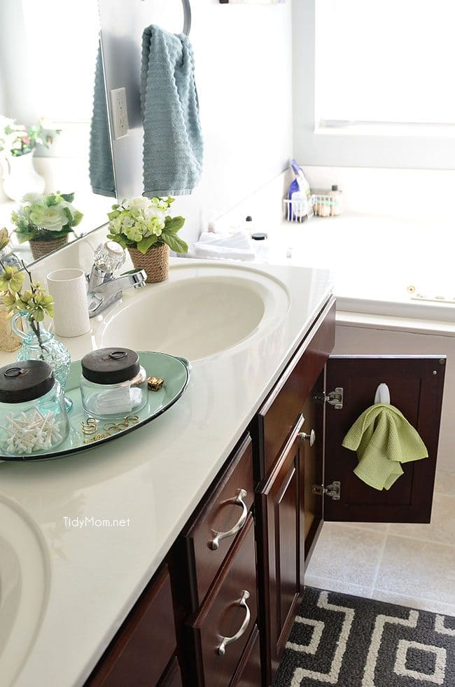 a microfiber cloth on the bathroom vanity door to clean the mirror and faucet daily. Tips on how to keep your house clean.