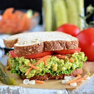 Avocado and chickpeas together make the most delicious sandwich spread! Get this Sweet Heat Chickpea Avocado Salad Sandwich recipe at TidyMom.net