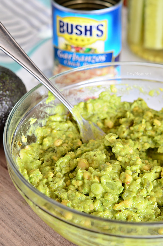 Smashed chickpeas and avocado together make the most delicious sandwich spread! Get this Sweet Heat Chickpea Avocado Salad Sandwich recipe at TidyMom.net