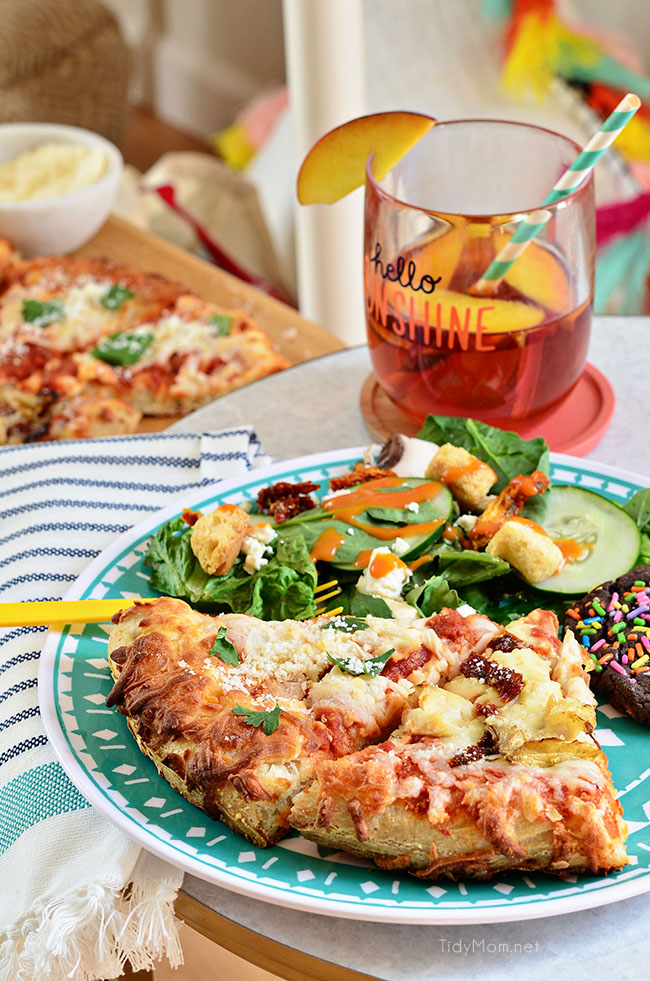 Girls Night Pizza Party! Customize a DIGIORNO Originial Rising Crust Four Cheese with your own toppings, like this Grilled Artichoke, Chicken and Sun-Dried Tomato Pizza with parmesan cheese. While the pizza bakes for about 20 minutes, set up a salad bar! Details at TidyMom.net