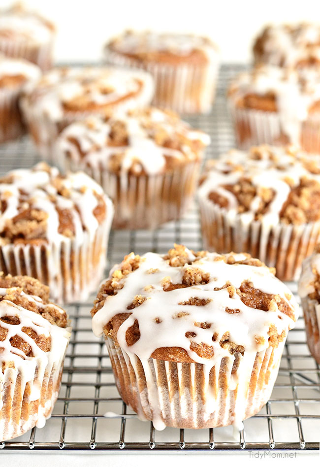 These Apple Spice Muffins with Streusel Topping have a surprise ingredient that packs them with fiber!! Applesauce, spices, baked beans, crumb topping, vanilla glaze combine to create a delicious breakfast treat or afternoon snack. Bake a batch and enjoy the warm fall flavors! muffin recipe at TidyMom.net