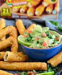 Perfect for snack time, or party time! Avocado Creme Sauce with Crunchy Chicken and Cheese Taquitos at TidyMom.net