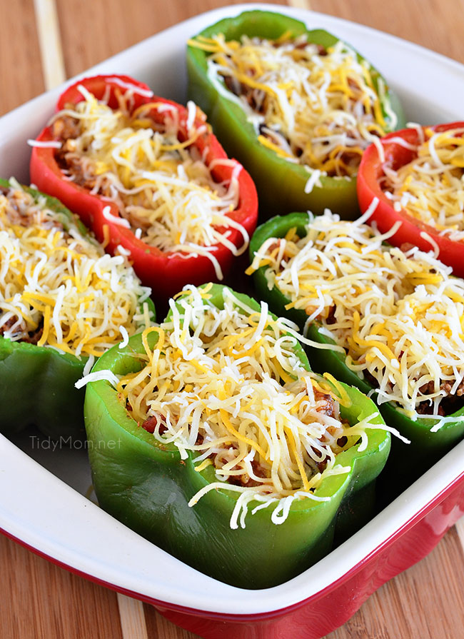 Bell peppers are filled with rice, browned ground beef, black beans, tomatoes, green chilies and cheese for an easy weeknight dinner with a southwest twist.