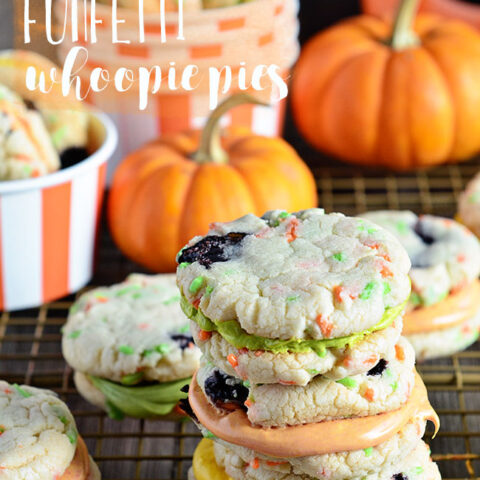 Funfetti Whoppie Pies are an easy and delicious cookie treat thanks to a box cake mix and canned frosting. Add seasonal sprinkles and food color to frosting. Get the recipe for these Halloween Funfetti Whoppie Pies at TidyMom.net