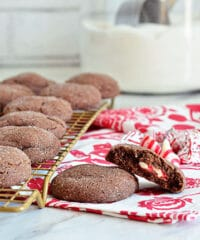 Super soft chocolate cookies hold a peppermint kiss in the center in these Peppermint Surprise Crinkle Cookies. So delicious