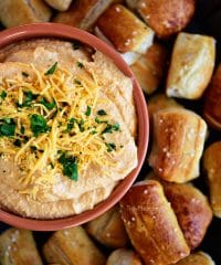 Pub-style Beer Cheese Dip with pretzel on tray