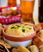 cheese dip with beer and pretzels