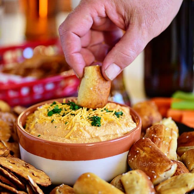 dipping pretzel in Pub-style Beer Cheese Dip