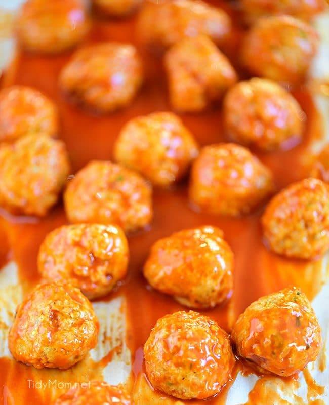 Crowd pleasing Buffalo Chicken Meatballs taste just like buffalo hot wings. Get the recipe at TidyMom.net