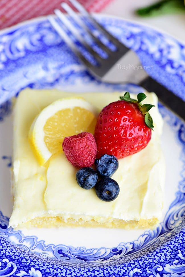 This no-fusslemon sheet cake is super moist and makes a wonderful spring or summer dessert that easily feeds a crowd. It may not be a fancy cake, but each slice is pure lemon bliss! print full recipe at TidyMom.net