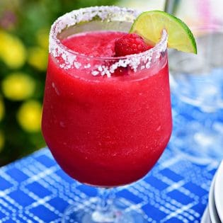 Frozen Rasberry Margarita is the perfect summer cocktail. Raspberry sorbet makes a refreshing twist on the traditional margarita, for a cool party sip! Get the full recipe at TidyMom.net