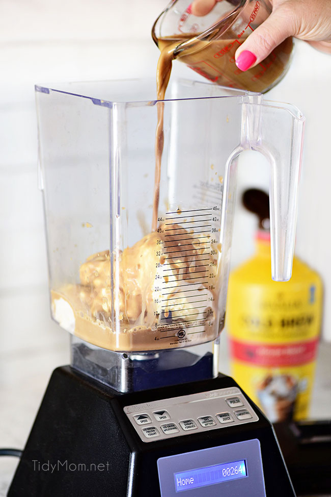 pouring Gooey Butter Cake Cold Brew Milkshake ingredients into blender