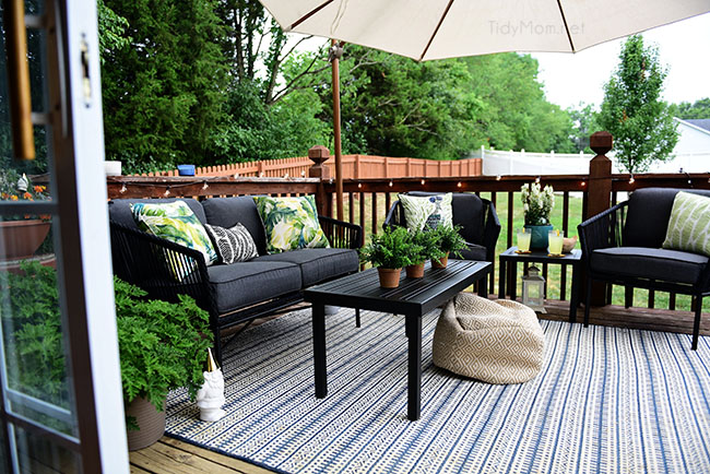 Maximize Outdoor Space! Learn How to Decorate a Small Deck or Patio and what kind of plants to use to keep mosquitos and other pests away. Get all the details at TidyMom.net