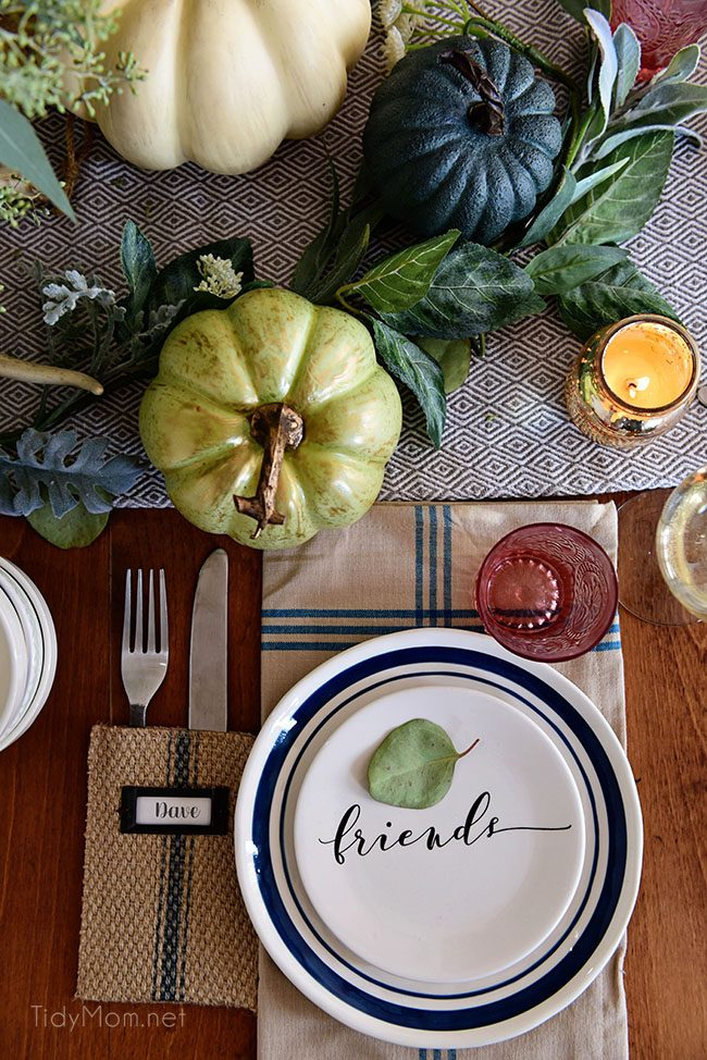 Friends Plate and Pumpkin: Seasonal Simplicity — Blue and Green Fall Tablescape with simple eucalyptus and pumpkins fall centerpiece . Get all the details along with 20+ Fall Home Tours at TidyMom.net