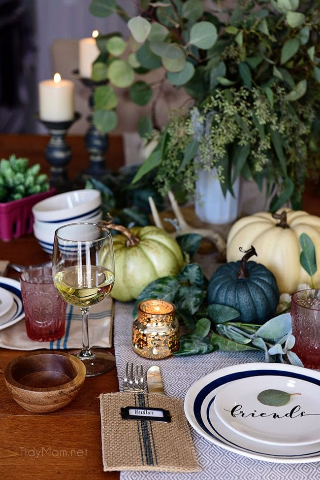 Seasonal Simplicity — Blue and Green Fall Tablescape with simple eucalyptus and pumpkins fall centerpiece . Get all the details along with 20+ Fall Home Tours at TidyMom.net