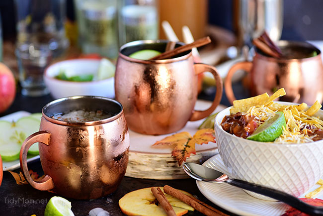 Caramel Apple Moscow Mule on copper mugs with a bowl of chili