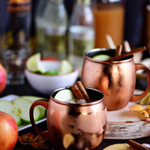 A Caramel Apple Moscow Mule is perfect for autumn! Made with sweet caramel vodka, fresh apple cider, and ginger beer it's sure to become a favorite fall cocktail! Get the recipe at TidyMom.net