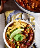 This flavorful Creamy Taco Chili is packed with lots of beans, chicken and other taco inspired ingredients. The perfect way to warm up on a chilly day! Printable recipe + video at TidyMom.net