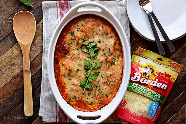 Borden Cheese makes this easy Cheesy Ravioli Bake Casserole with Chicken impossible to resist.
