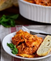 Cheesy Ravioli Bake Casserole with Chicken is easy to make and impossible to resist. Making it the perfect weeknight dish. Cheese ravioli, marinara sauce, chicken and lots of cheese, all layered and baked until bubbly and gooey! Print recipe + view short recipe video at TidyMom.net