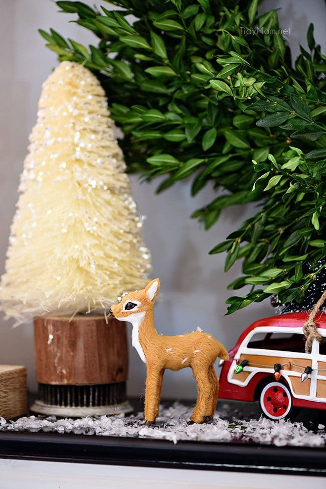 Bottlebrush Tree with doe and car. Merry and Bright Christmas Mantel Decor with rustic neutrals and a touch of red and green. Details at TidyMom.net