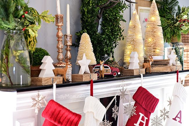 Christmas Mantel Decor with rustic neutrals and a touch of red and green.
