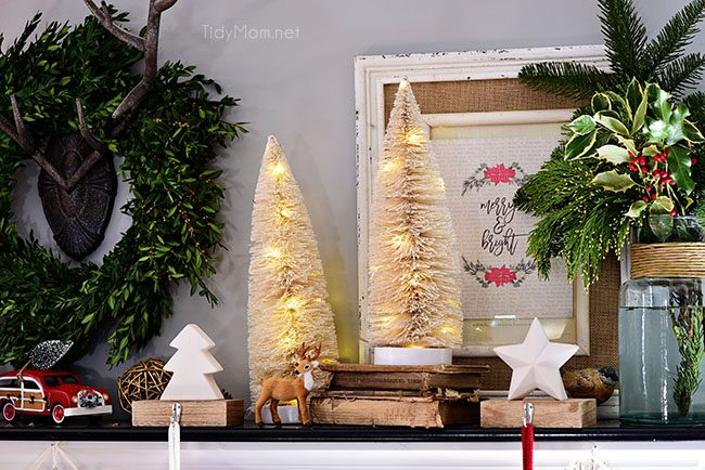 Lighted Bottle Brush Trees. Merry and Bright Christmas Mantel Decor with rustic neutrals and a touch of red and green. Details at TidyMom.net