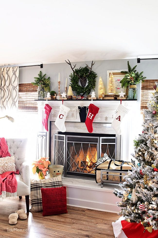 Merry and Bright Christmas Mantel Decor with rustic neutrals and a touch of red and green. Details at TidyMom.net