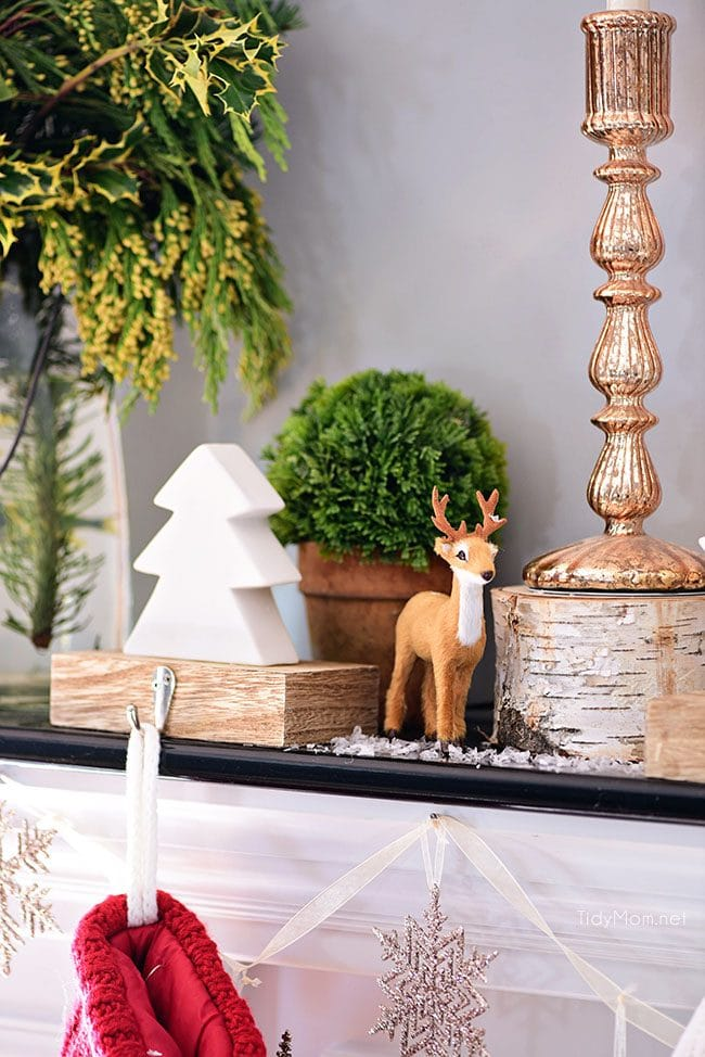 Deer + Tree Stocking Holder. Merry and Bright Christmas Mantel Decor with rustic neutrals and a touch of red and green. Details at TidyMom.net